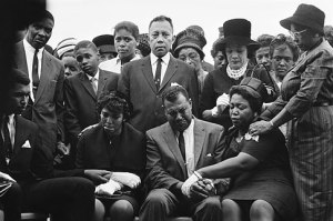 The family of Carol Robertson, a 14-year-old African American girl killed in a church bombing, attend graveside services for her, Sept. 17, 1963, Birmingham, Ala. Seated left to right: Carol Robertsons sister Dianne and parents, Mr. Alvin Robertson Sr. and Mrs. Alpha Robertson. The others are unidentified. (AP Photo/Horace Cort)